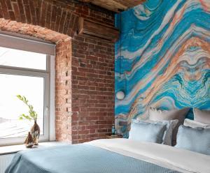 Кровать или кровати в номере Ситикомфорт на Тверской