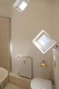 A bathroom at Villa Greve - Deluxe Appartement