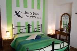 A bed or beds in a room at Country House Maremma Nel Tufo