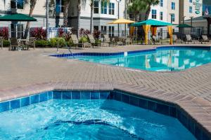 The swimming pool at or near Homewood Suites by Hilton Orlando-Nearest to Universal Studios