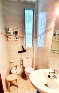 Un baño de Apartamentos Kitema