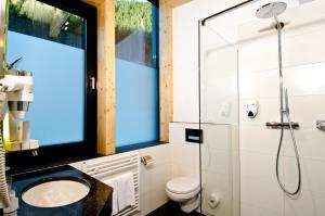 A bathroom at Astellina hotel-apart