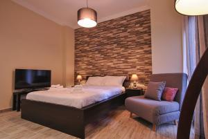 A bed or beds in a room at Studio 20 (the best spot in town !)