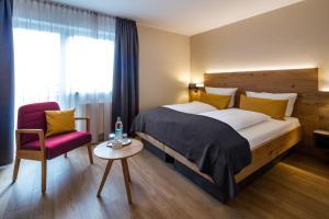 Ein Bett oder Betten in einem Zimmer der Unterkunft Landhotel Endhart