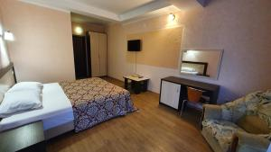 Кровать или кровати в номере Отель Авалон