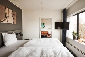 En eller flere senge i et værelse på Comwell Kolding