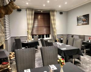A restaurant or other place to eat at Haughton Arms Hotel