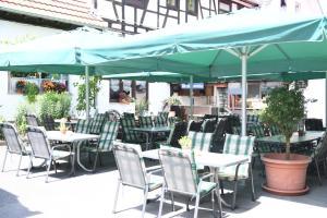 Ein Restaurant oder anderes Speiselokal in der Unterkunft Hotel- Landgasthof Baumhof-Tenne