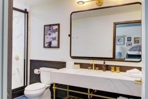 A bathroom at Best Western Plus Hollywood Hills Hotel