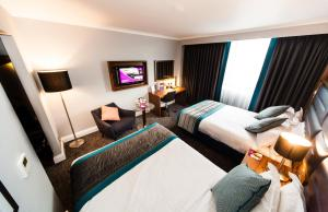 A bed or beds in a room at Crowne Plaza Leeds, an IHG Hotel
