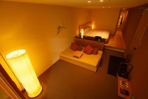 A bed or beds in a room at Kinnotake Tonosawa (Adult Only)
