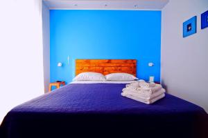 A bed or beds in a room at B&B il Faro