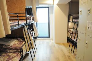 A bunk bed or bunk beds in a room at 04village Namba