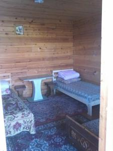 A bed or beds in a room at Chastnaya Usadba Stanitsa