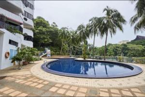 The swimming pool at or close to Susie's VIP Suites Sri Sayang Apartment