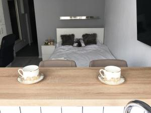 A bed or beds in a room at GalDan vacation apartments