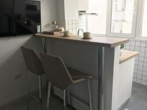 A kitchen or kitchenette at GalDan vacation apartments