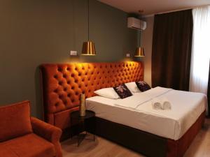 Ein Bett oder Betten in einem Zimmer der Unterkunft Boutique Hotel St Georgije