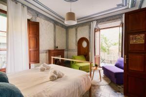 Ein Bett oder Betten in einem Zimmer der Unterkunft Hostel Sóller - Albergue Juvenil