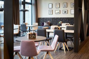 Ein Restaurant oder anderes Speiselokal in der Unterkunft the niu Air