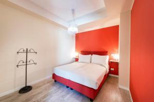 Кровать или кровати в номере Residence Lenno