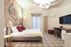 A bed or beds in a room at Moscova Luxury B&B