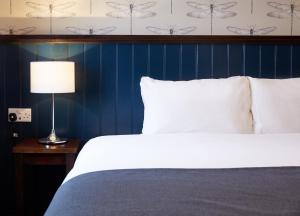 A bed or beds in a room at Charnwood Arms