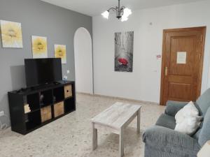 Zona de estar de Apartamentos Casa Sardina