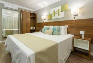 Cama ou camas em um quarto em Hotel Villa Fiori