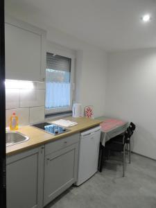 A kitchen or kitchenette at Trenta Apartman Bükfürdő