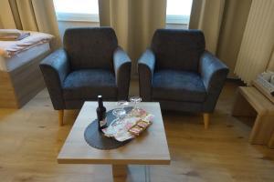 """Ein Sitzbereich in der Unterkunft Gasthof & Restaurant """"Am Kreuz"""""""