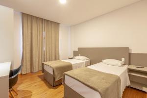 A bed or beds in a room at Tri Hotel São João Batista