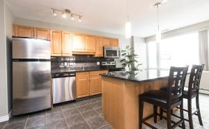 A kitchen or kitchenette at Canterra Suites Hotel