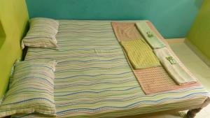 A bed or beds in a room at Rashmitha Guest House
