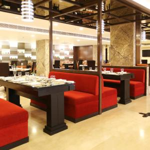 A restaurant or other place to eat at Golden Tulip Jaipur