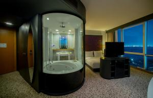 A television and/or entertainment center at DoubleTree By Hilton Istanbul - Moda