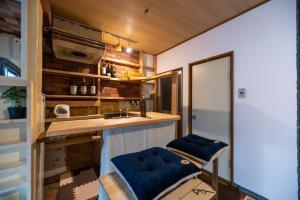 A kitchen or kitchenette at Dotombori Base