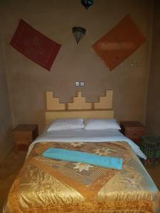 A bed or beds in a room at Family Moroccan House