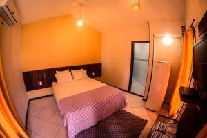 Cama ou camas em um quarto em Pousada Porto