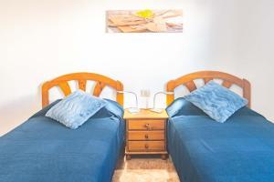 A bed or beds in a room at Apartamento Mirafondo
