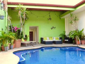 The swimming pool at or near Hotel La Guaria Inn & Suites