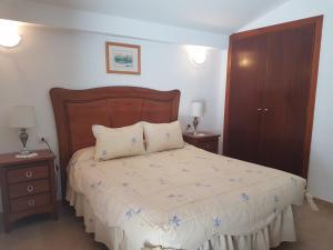 Cama o camas de una habitación en Vivienda Vacacional la Palmera