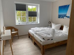 Ein Bett oder Betten in einem Zimmer der Unterkunft Fewo Barth