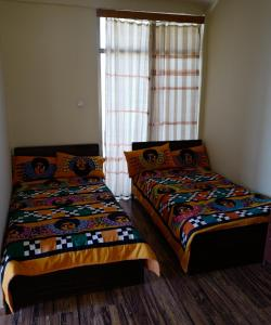 A bed or beds in a room at Red Rock Lalibela Hotel