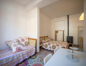 A bed or beds in a room at Guesthouse Le Oche di Bracchio