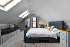 A bed or beds in a room at The Bell Inn