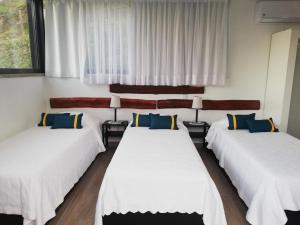 Uma cama ou camas num quarto em Casa dos Becos