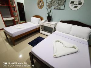 A bed or beds in a room at Ramz Residence