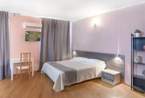 A bed or beds in a room at Al Borgo