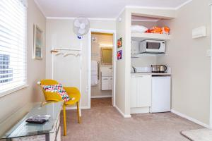 A kitchen or kitchenette at STUDIO @ 91